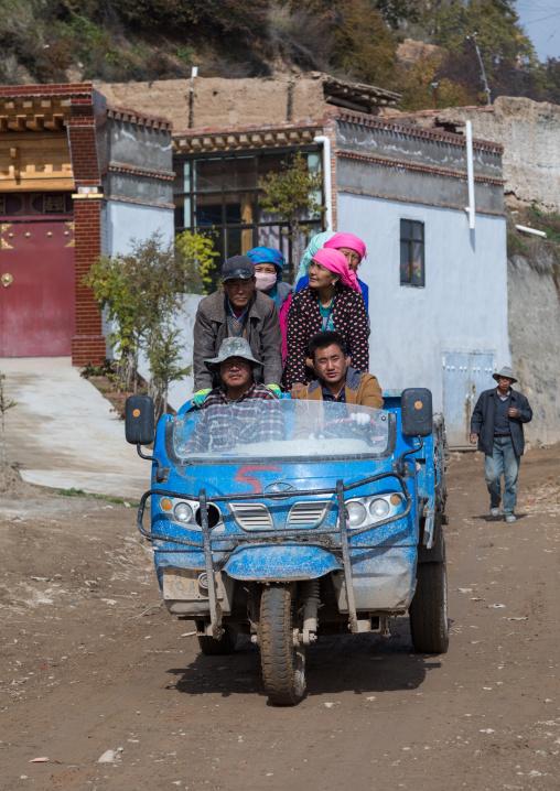 Tibetan workers on a three-wheeled chinese truck, Qinghai Province, Wayaotai, China