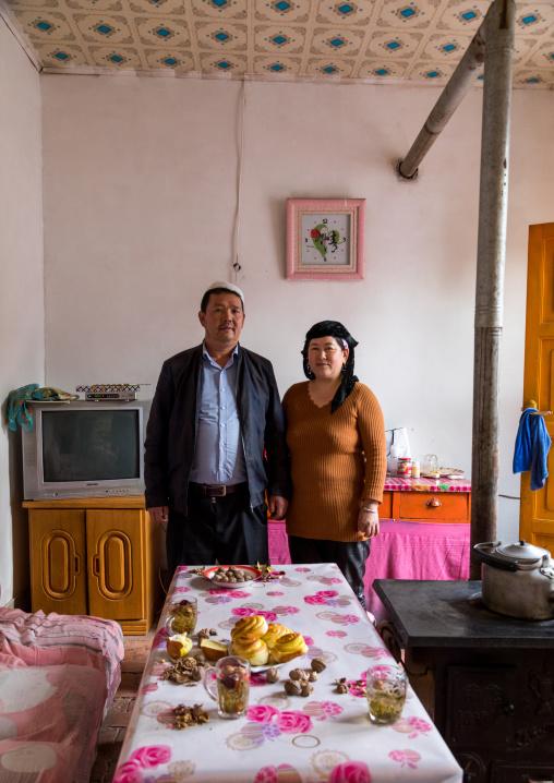 Salar ethnic minority couple inside their house, Qinghai province, Xunhua, China