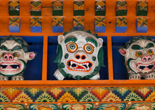 Monsters statues above the entrance of the temple in Bongya monastery, Qinghai province, Mosele, China
