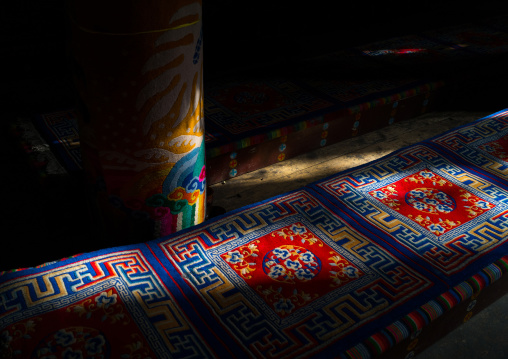 Ray of light on the seats and carpets in Rongwo monastery, Tongren County, Longwu, China