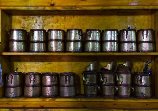 Metal pots inside the monks kitchen in Rongwo monastery, Tongren County, Longwu, China