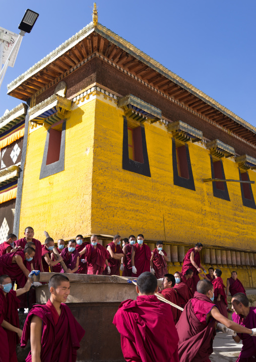 Monks preparing the painting of a temple in Rongwo monastery, Tongren County, Longwu, China