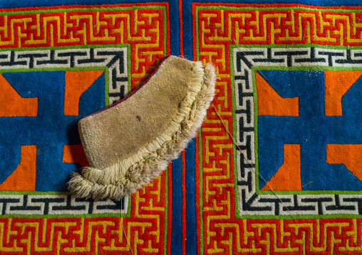 Yellow hat sect on a carpet with swastikas inside Bongya monastery, Qinghai province, Mosele, China