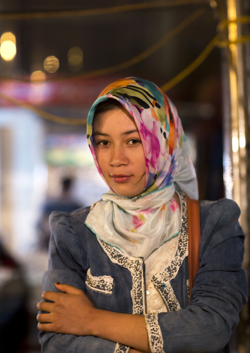 Young Uyghur Woman In Night Market, Hotan, Xinjiang Uyghur Autonomous Region, China