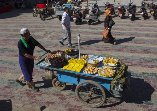 Uyghur Man Pulling A Mobile Food Stall, Yarkand, Xinjiang Uyghur Autonomous Region, China