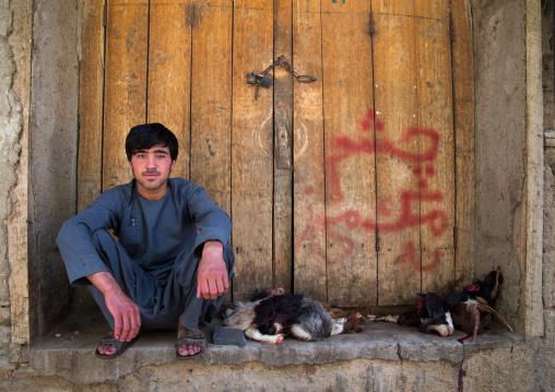 Afghan seller with goats heads, Badakhshan province, Ishkashim, Afghanistan