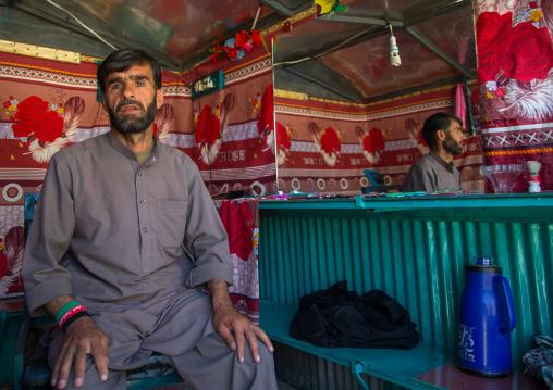 Afghan barber in the market, Badakhshan province, Ishkashim, Afghanistan