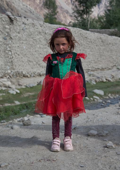 Girl wearing a shirt with the afghan flag colors, Badakhshan province, Khandood, Afghanistan