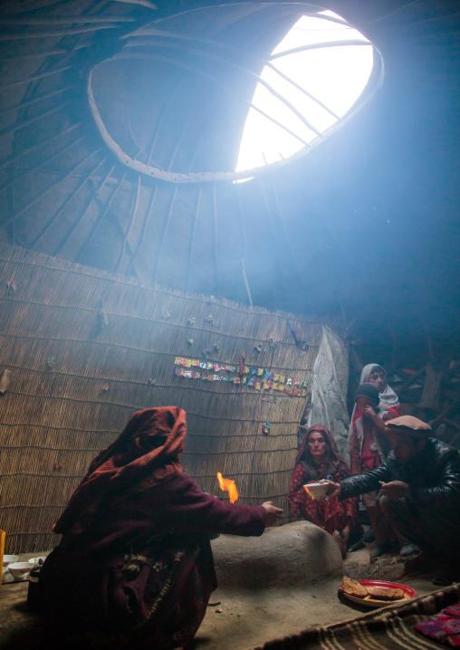 Wakhi nomad family eating breakfast inside their yurt, Big pamir, Wakhan, Afghanistan