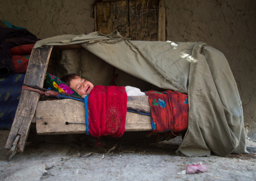 Baby sleeping in a craddle, Badakhshan province, Qazi deh, Afghanistan
