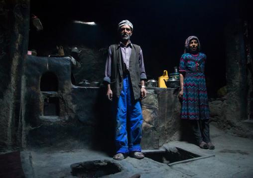 Afghan couple inside their traditional pamiri house, Badakhshan province, Qazi deh, Afghanistan