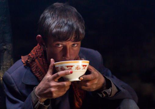 Wakhi teenage boy drinking salty milk tea, Big pamir, Wakhan, Afghanistan