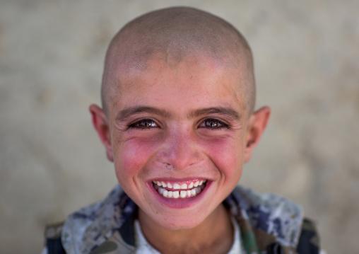 Smiling afghan boy with head shaved, Badakhshan province, Khandood, Afghanistan