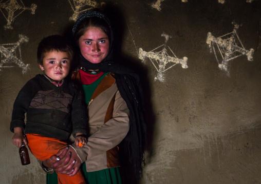 Afghan children in front of nowruz decorations on the walls, Badakhshan province, Zebak, Afghanistan