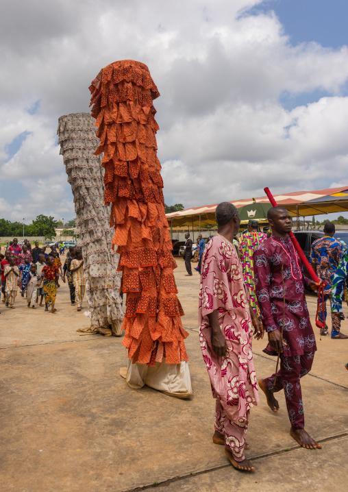 Benin, West Africa, Porto-Novo, men guiding a zangbeto guardian of the night spirit