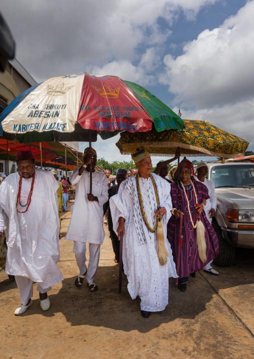 Benin, West Africa, Porto-Novo, traditional beninese king alajase onikoyi abessan king walking under an umbrella