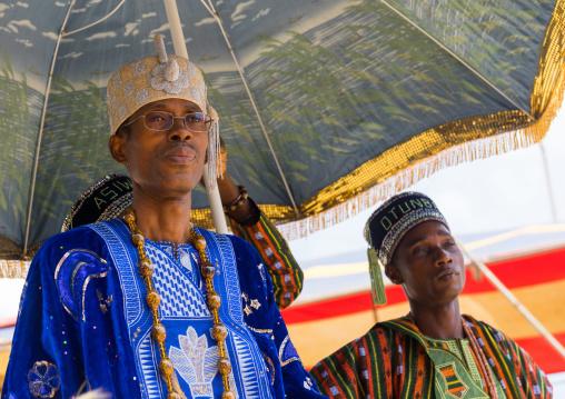 Benin, West Africa, Porto-Novo, king gbèmédô tognon zounon walking under an umbrella