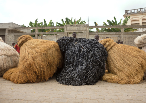Benin, West Africa, Porto-Novo, zangbetos guardians of the night spirit resting in the street