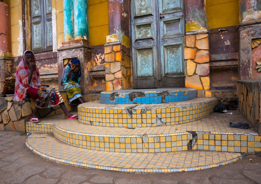 Benin, West Africa, Porto-Novo, teenagers sit on the stairs of the central mosque