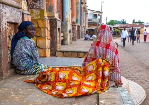 Benin, West Africa, Porto-Novo, teenagers sit in front of the multicoloured great mosque
