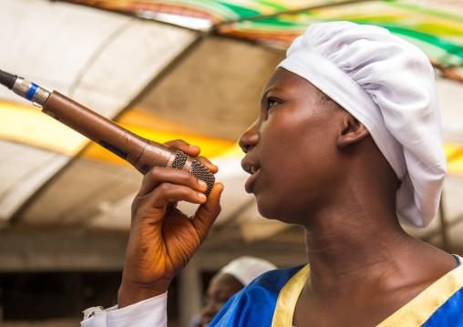 Benin, West Africa, Ganvié, celestial church of christ woman praying and singing