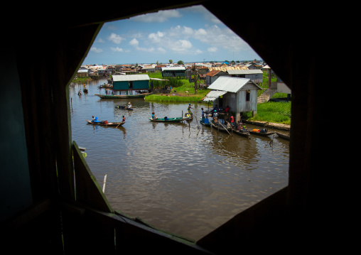 Benin, West Africa, Ganvié, boats queueing to collect fresh water on lake nokoue