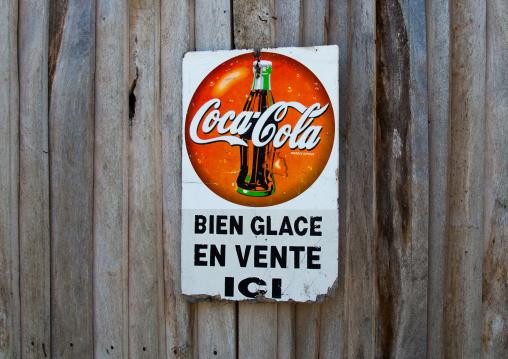 Benin, West Africa, Ganvié, a coca cola sign adverstising on a wooden door