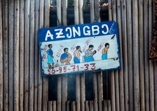 Benin, West Africa, Ganvié, roadside sign for traditional witchcraft