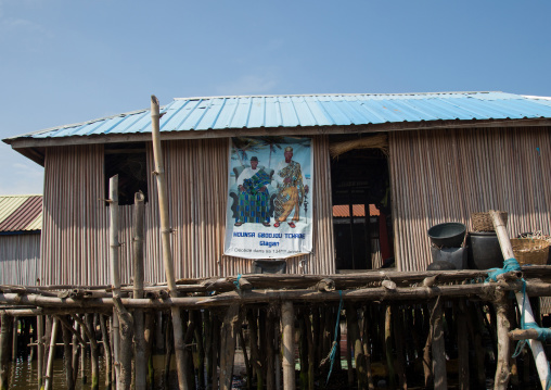 Benin, West Africa, Ganvié, death annoucement on the wall of a stilt house on lake nokoue