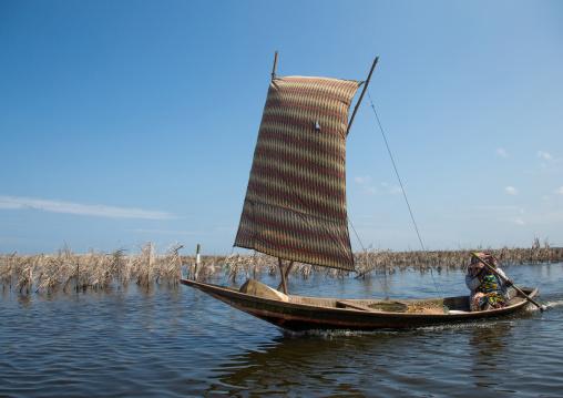 Benin, West Africa, Ganvié, boat sailing on lake nokoue