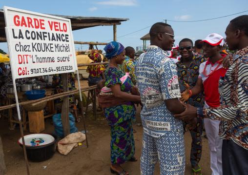 Benin, West Africa, Ganvié, beninese people chatting on a market