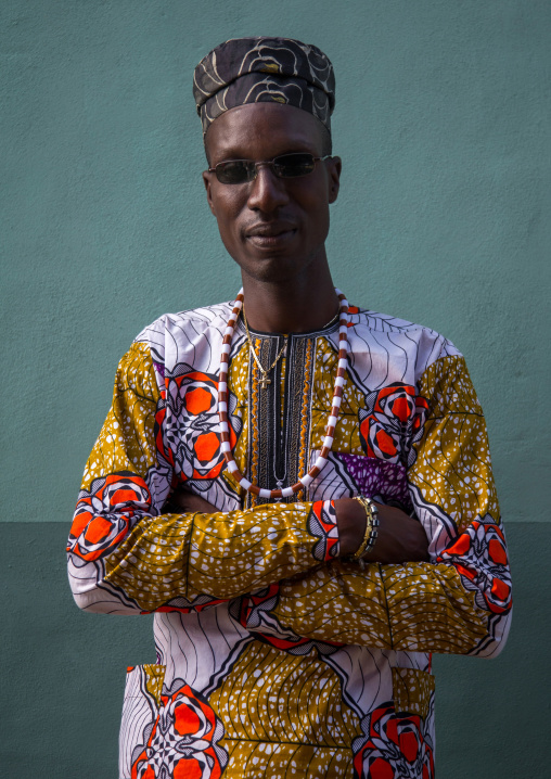 Benin, West Africa, Ganvié, fashionable blind young man with arms crossed
