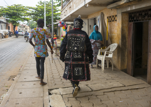 Benin, West Africa, Porto-Novo, egoun egoun spirit of the deads walking in the street with his guide to ask money to people
