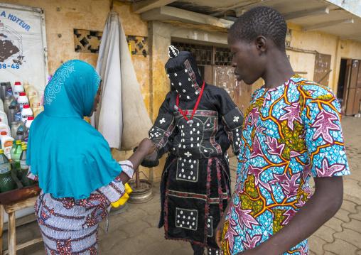 Benin, West Africa, Porto-Novo, egoun egoun spirit of the deads asks money to people in exchange of blessings