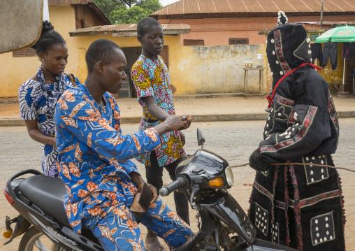 Benin, West Africa, Porto-Novo, egoun egoun spirit of the deads asks money to a driver in exchange of blessings
