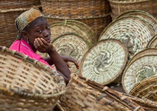 Benin, West Africa, Adjara, woman selling baskets on a market