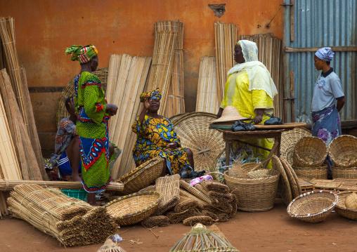 Benin, West Africa, Adjara, women selling baskets on a market