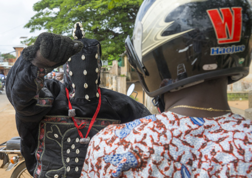 Benin, West Africa, Porto-Novo, egoun egoun spirit of the deads asks money to a man in exchange of blessings