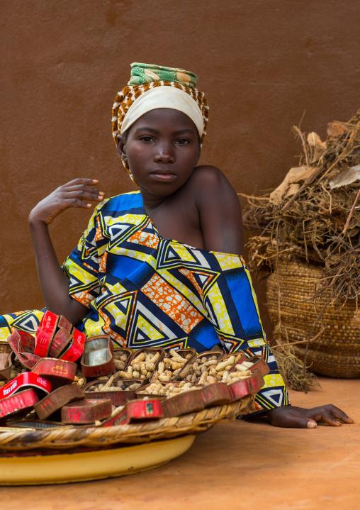 Benin, West Africa, Adjara, girl selling peanuts on a market