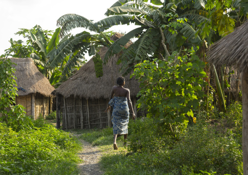 Benin, West Africa, Onigbolo Isaba, holi tribe woman passing in front of traditional houses