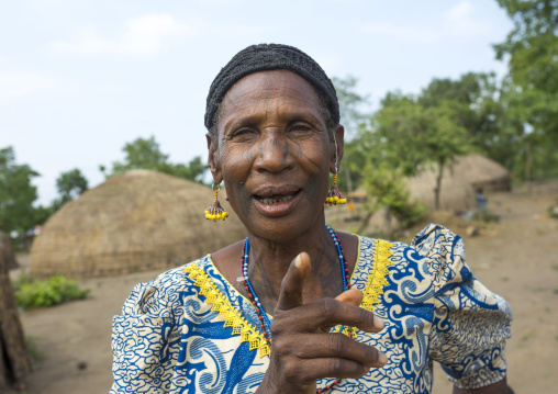 Benin, West Africa, Gossoue, a happy tattooed fulani peul woman