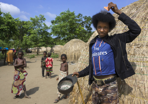Benin, West Africa, Gossoue, young fulani peul man with fashionable clothes and afro hair