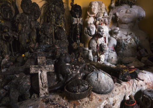 Benin, West Africa, Bonhicon, statues covered with oil and blood inside a voodoo temple for a ceremony