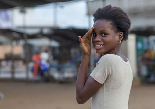 Benin, West Africa, Porto-Novo, portrait of a shy beninese girl in the street