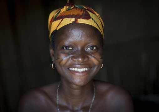 Benin, West Africa, Onigbolo Isaba, smiling holi tribe woman covered with traditional facial tattoos and scars