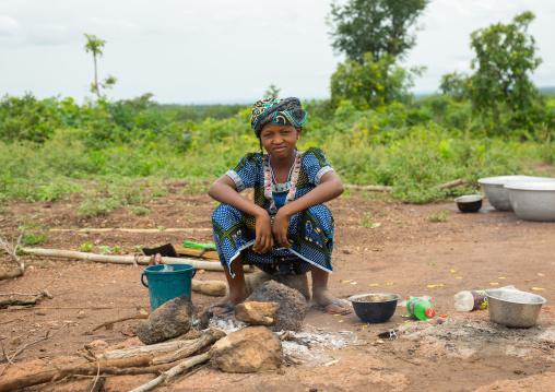 Benin, West Africa, Taneka-Koko, a young fulani peul tribe girl cooking