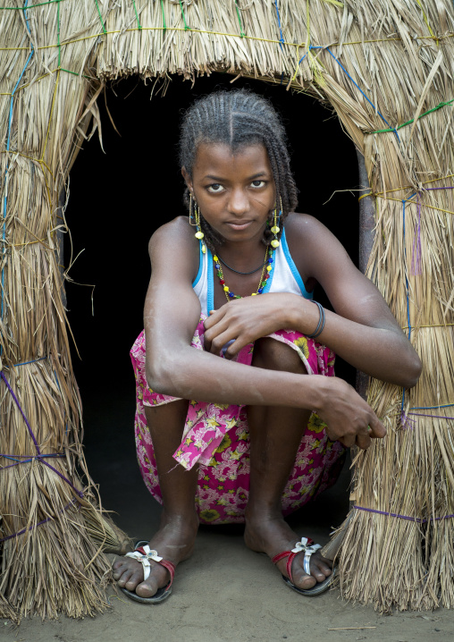 Benin, West Africa, Gossoue, a beautiful fulani peul tribe teenager at the entrance of her hut