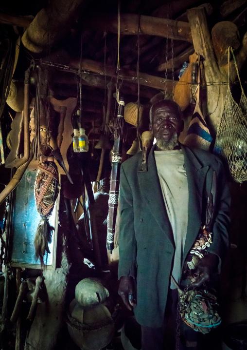 Benin, West Africa, Boukoumbé, mr kouagou maxon in his traditional tata somba house and his traditional medicine