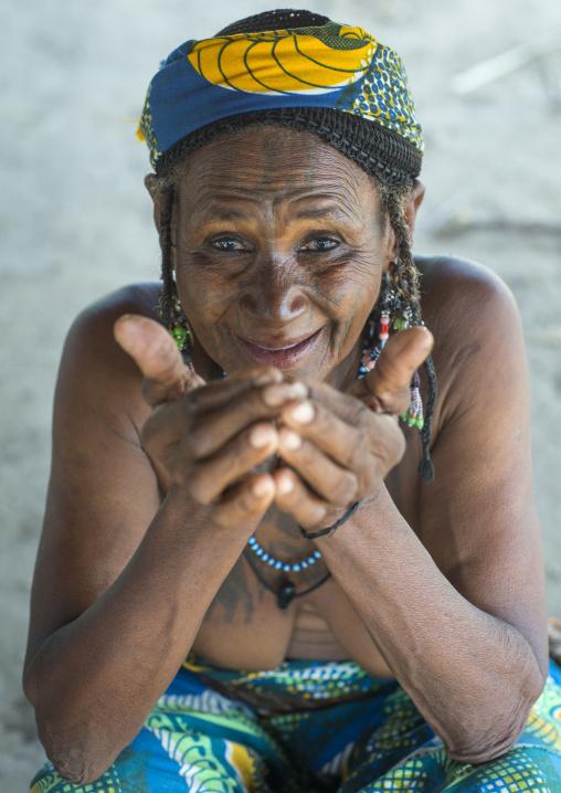 Benin, West Africa, Gossoue, an old tattooed fulani peul tribe woman portrait