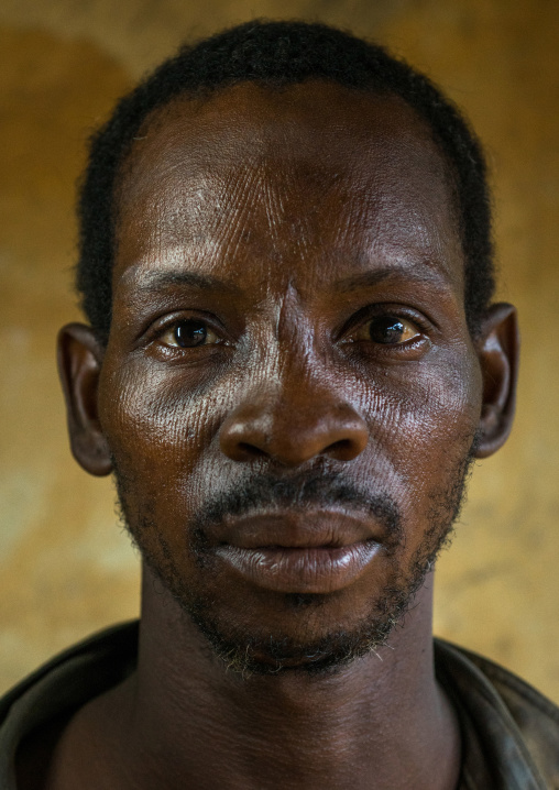 Benin, West Africa, Koussou, a somba tribe man with his face covered with linear scars